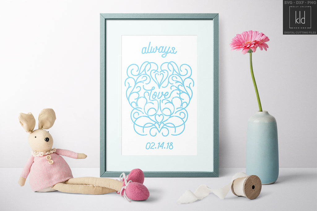 Anniversary Wall Art made using the Love svg cut file in light blue