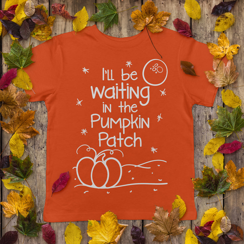Orange child's shirt with the I'll Be Waiting in the Pumpkin Patch svg in all white