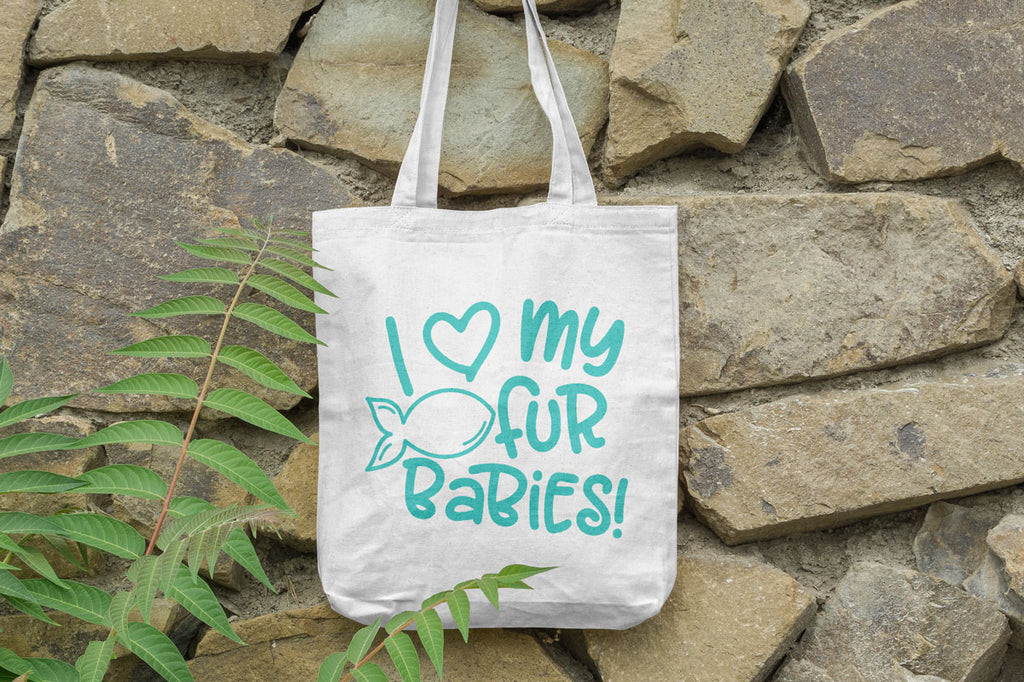 Canvas tote with the I Love My Cat Fur Babies svg in teal