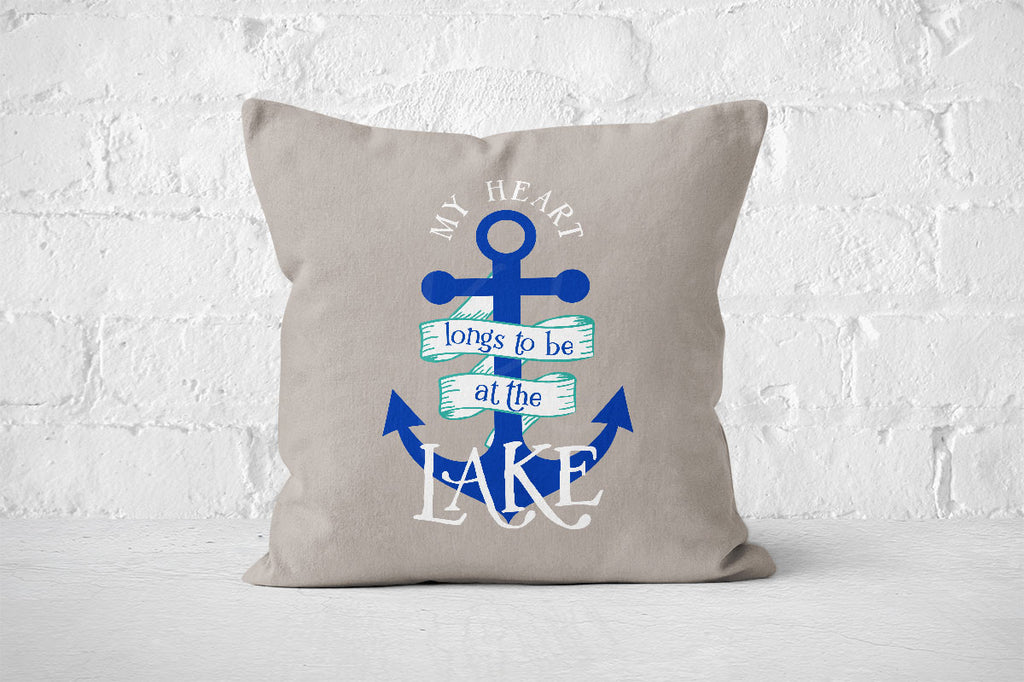 Taupe throw pillow with the My Heart Longs to Be at the Lake svg cut file in white, blue and teal
