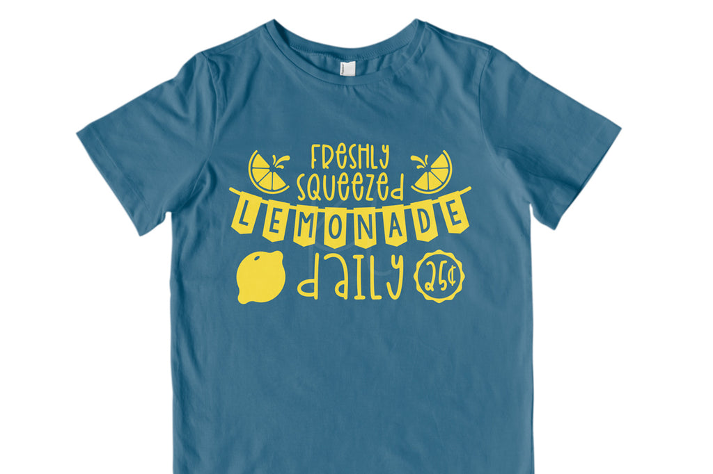 Children's blue shirt with the Lemonade Stand svg cut file in yellow