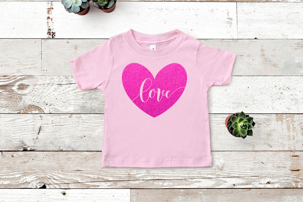 Love heart svg cut file in glitter on a toddler shirt