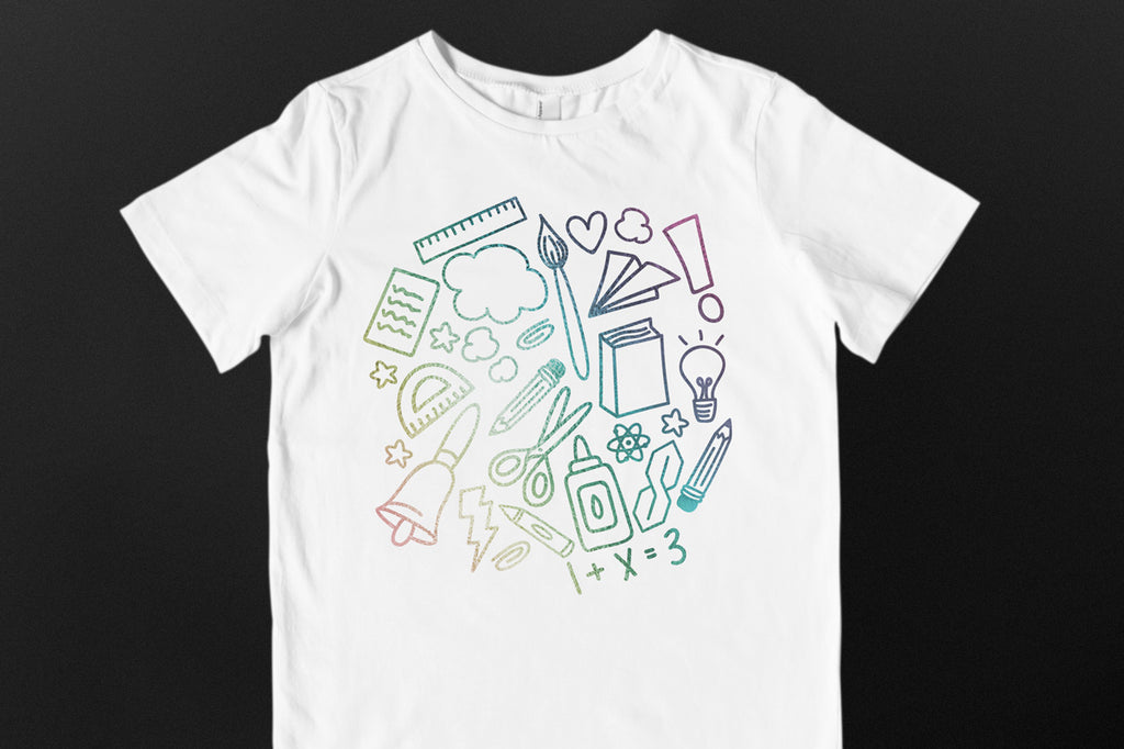 Child's white shirt with the School Doodle Cloud svg cut file in holographic vinyl