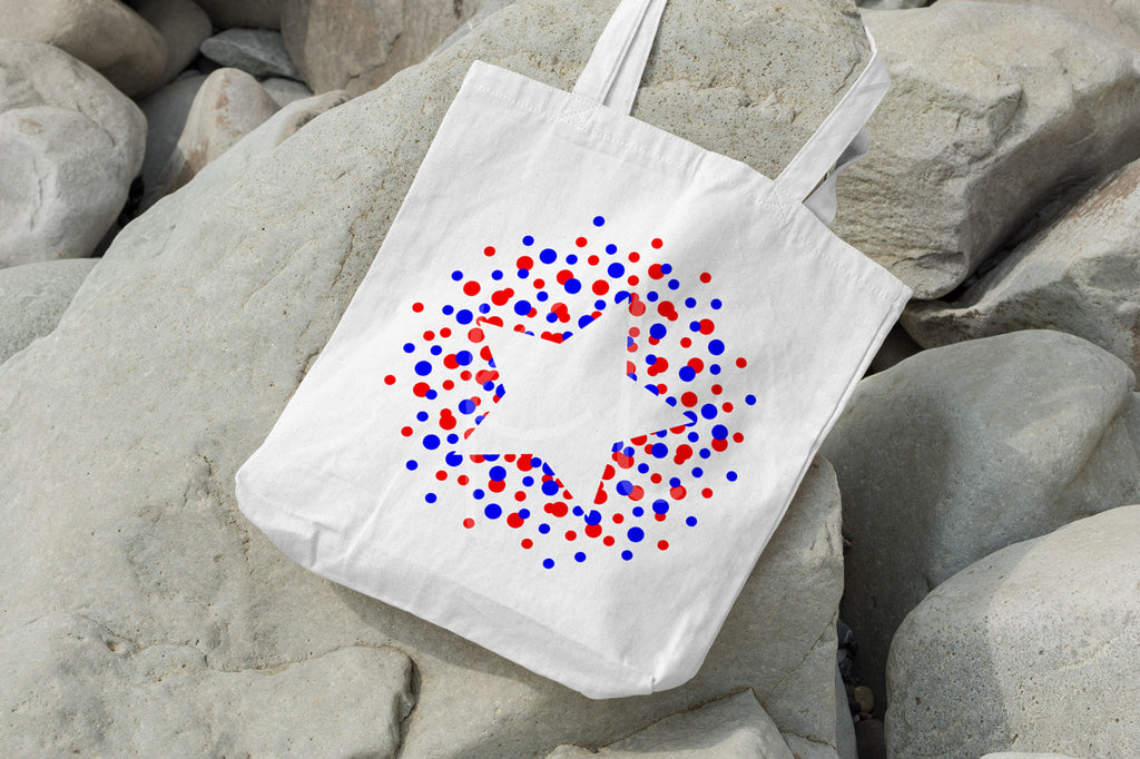 Canvas tote with the Polka Dot Outlined Star svg cut file in red and blue