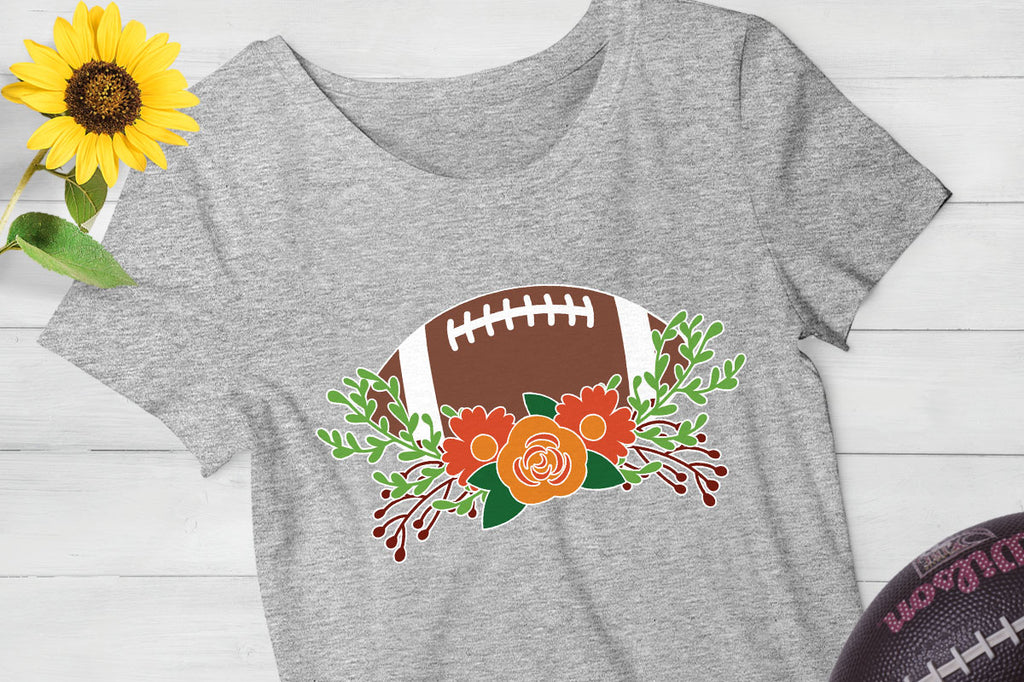 Women's grey t-shirt with the Football and Flowers svg cut file in fall colors