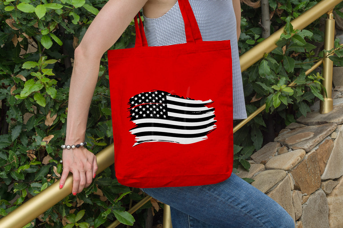 Red canvas tote with the Distressed American Flag svg in black and white