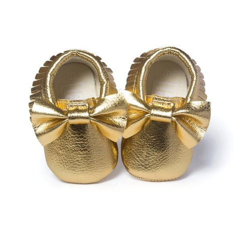 Shiny Gold Shoes With Bow