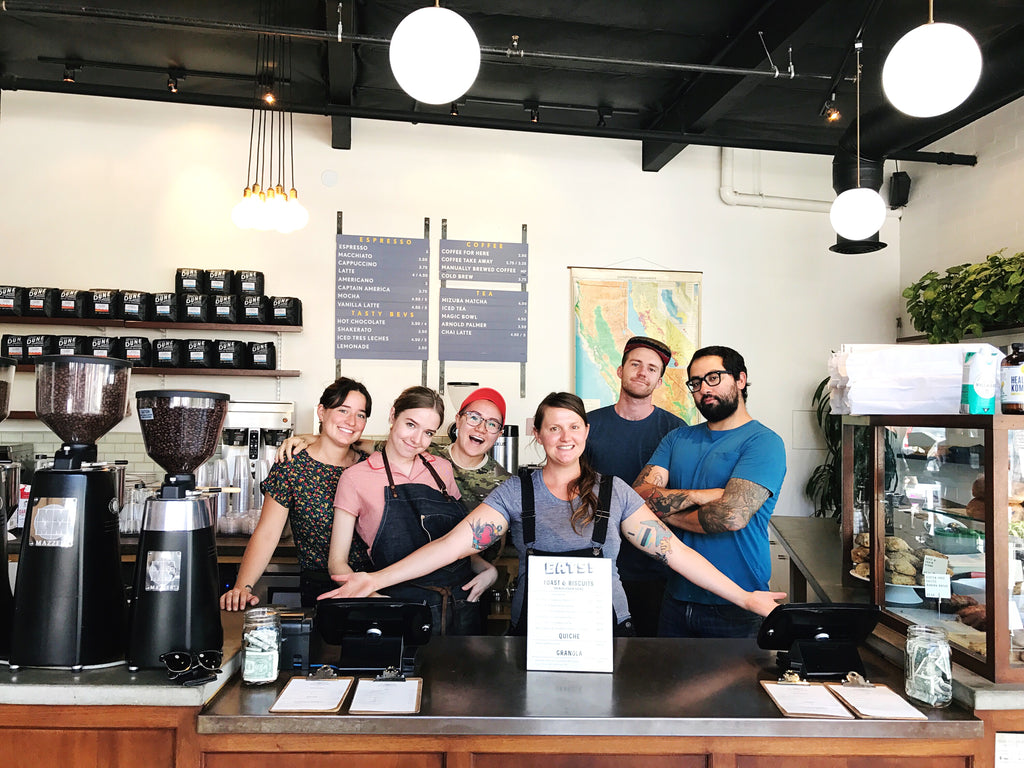 6 members of the Dune team stand behind the counter at our Anacapa location.