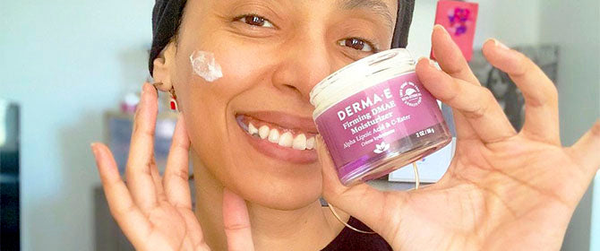 Woman applying firm and lift moisturizer to her face