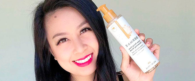 Woman holding Derma E Acne Cleansing Wash