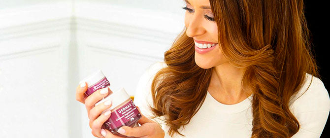 Woman holding Skin Restore line products