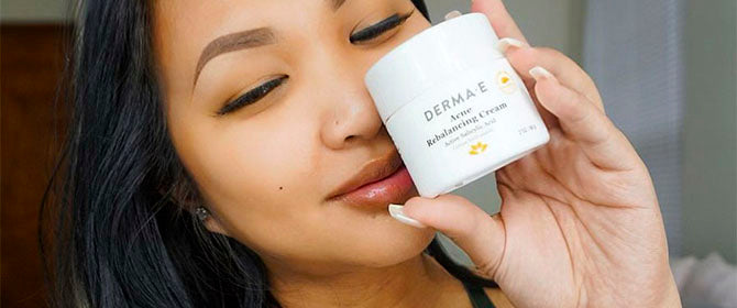 Woman holding up the Dermae Acne Treatment Cream
