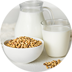 Soy Beans in bowl with milk in carafe.