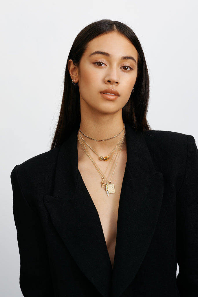 Full view model wearing 111 Choker paired with other necklace styles  Bagatiba