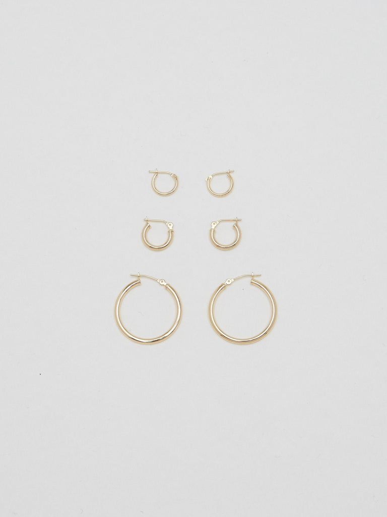 Full view flat lay of 14K 1M Hoops next to 2M & 3M Earrings Bagatiba