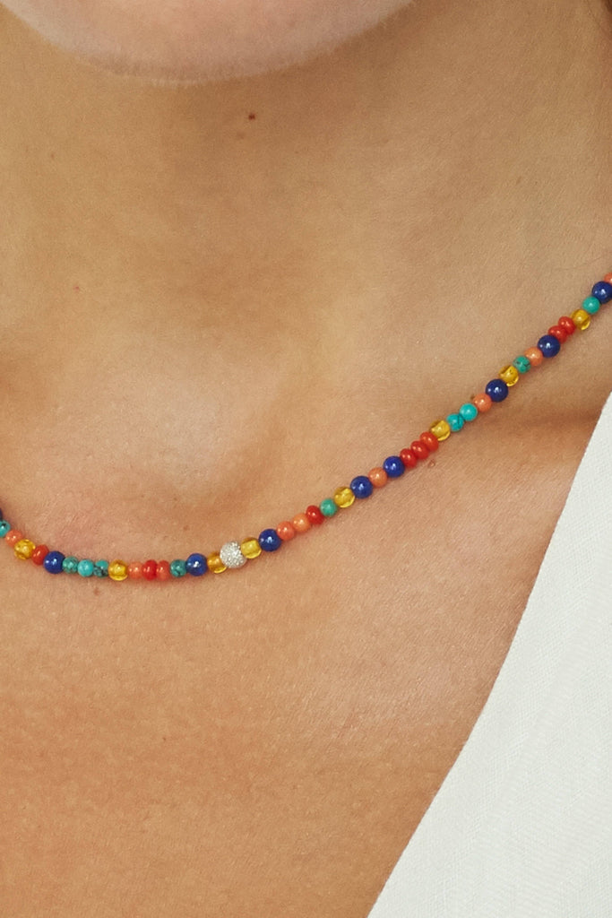 Zoomed crop on model of 14K Diamond Multi-Bead Necklace Necklace bagatiba