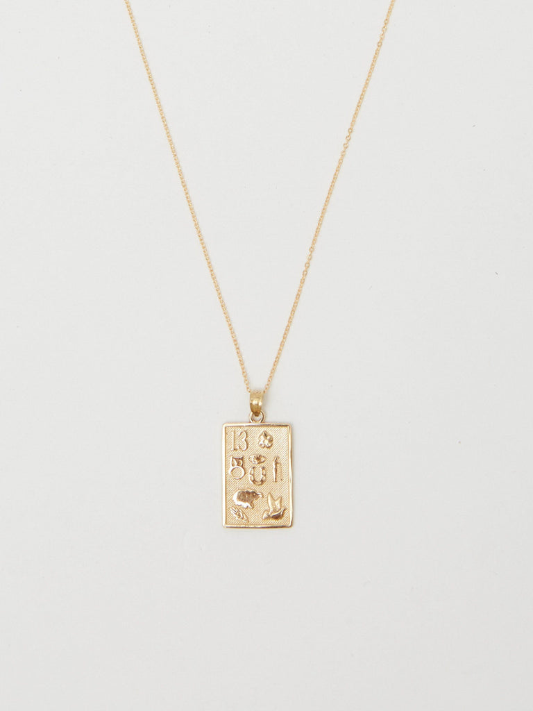 Cropped view flat lay of 14K Lucky Charm Necklace Necklace Bagatiba
