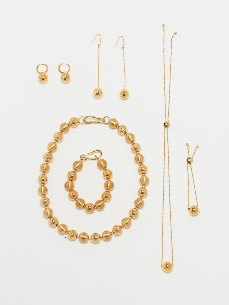 Full view flat lay of Adjustable Sphere Necklace and collection  bagatiba