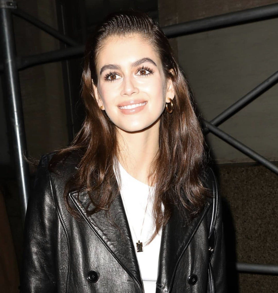 Kaia Gerber wearing Bagatiba Long Cage Necklace and Mini Gold Hollow Hoops  Bagatiba