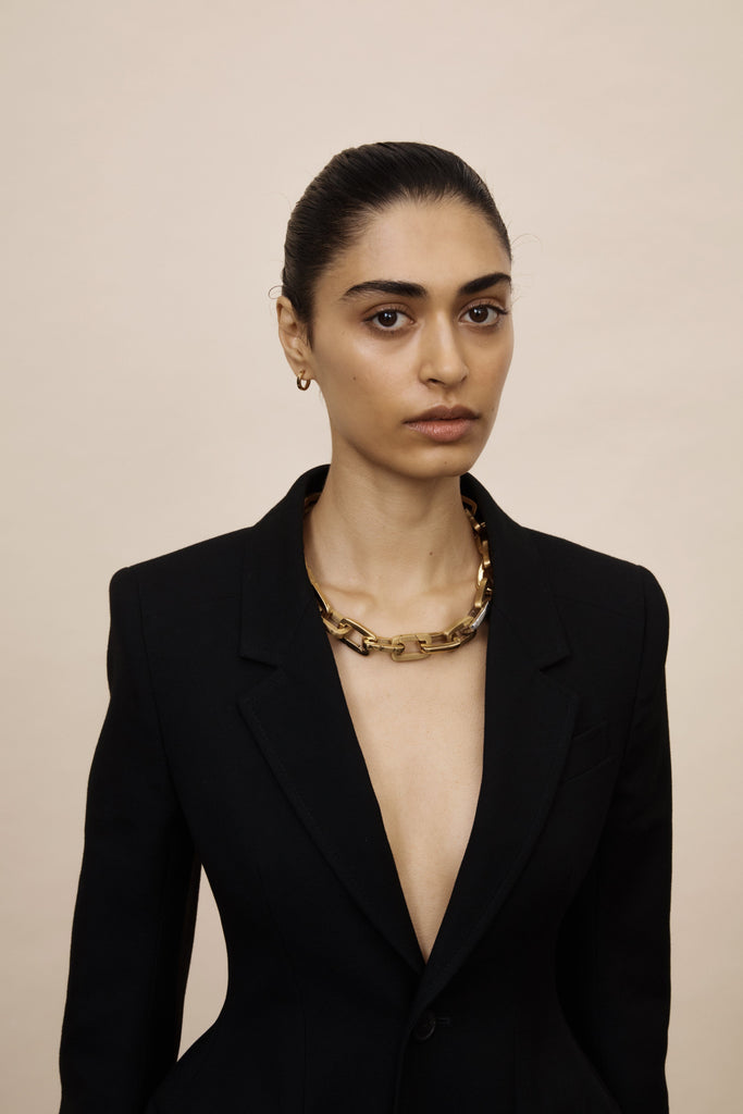 Full view of model wearing a necklace made of Brushed Gold Cara Clip Body Bagatiba