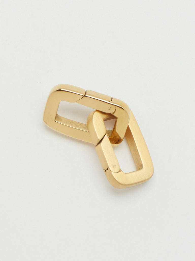 Detail flat lay view of Brushed Gold Cara Clip linked with Gold Cara Clip  Bagatiba