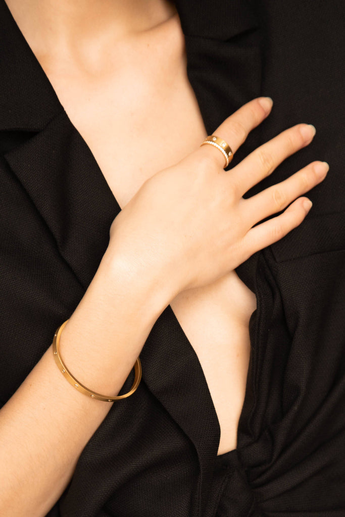 Cropped view of Model's hand and torso wearing Diamond Ring, Gemma Ring and Gemma Bracelet  Bagatiba