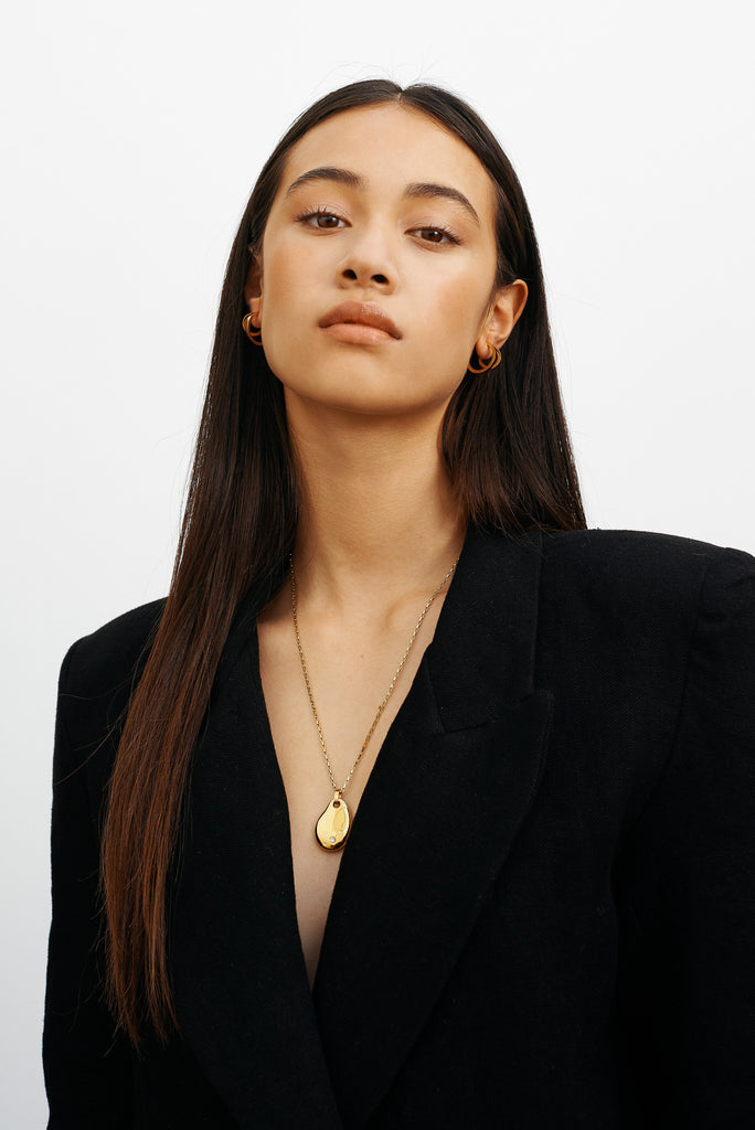 Model wearing the Diamond Stone Necklace and Bagatiba Hoops
