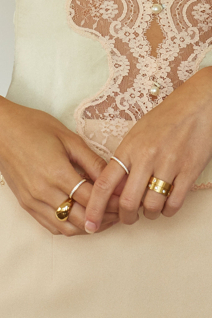 Close view of model wearing multiple rings including the Ella Diamond Ring Ring Bagatiba