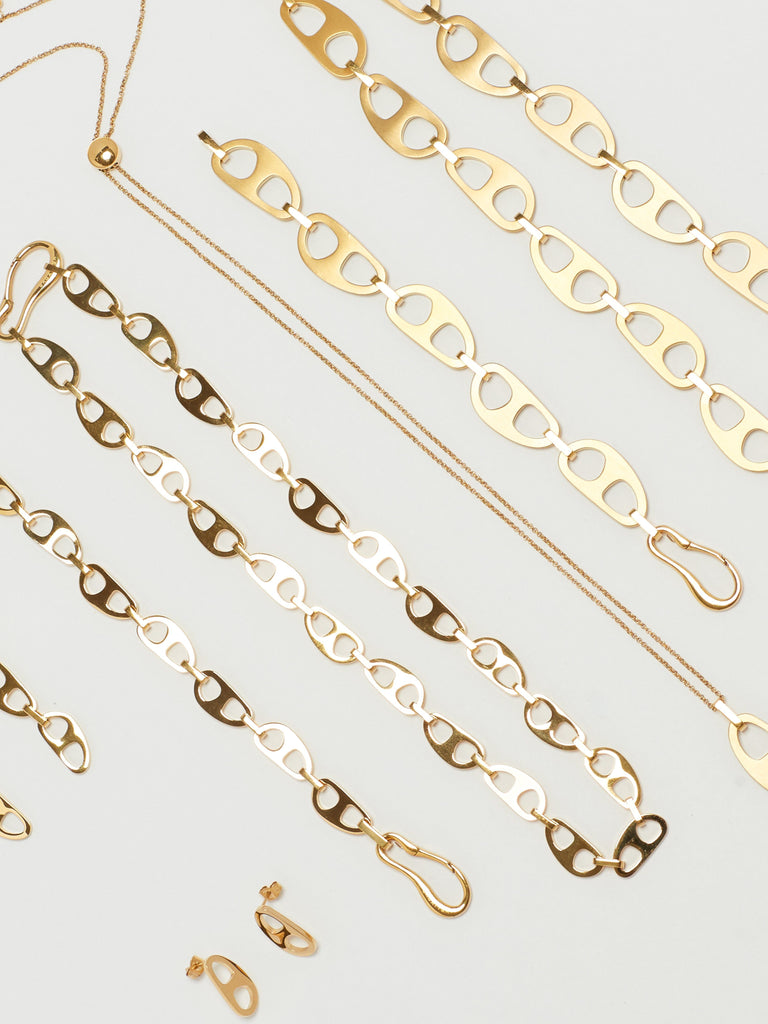 Cropped flat lay view of Gold Brushed Tab Bracelet with Tab Collection bagatiba