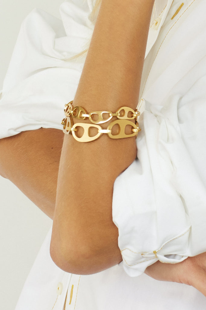 Cropped view on model wearing Gold Brushed Tab Bracelet & Small Gold Tab Bracelet bagatiba