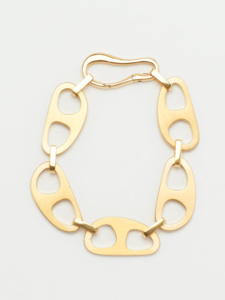 close up flat lay of Gold Brushed Tab Bracelet Bracelet bagatiba