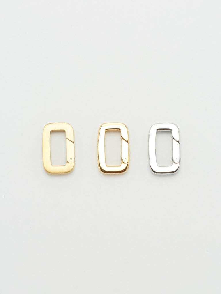 Top view flat lay of Gold, Brushed Gold & Silver  Cara Clip Body Bagatiba