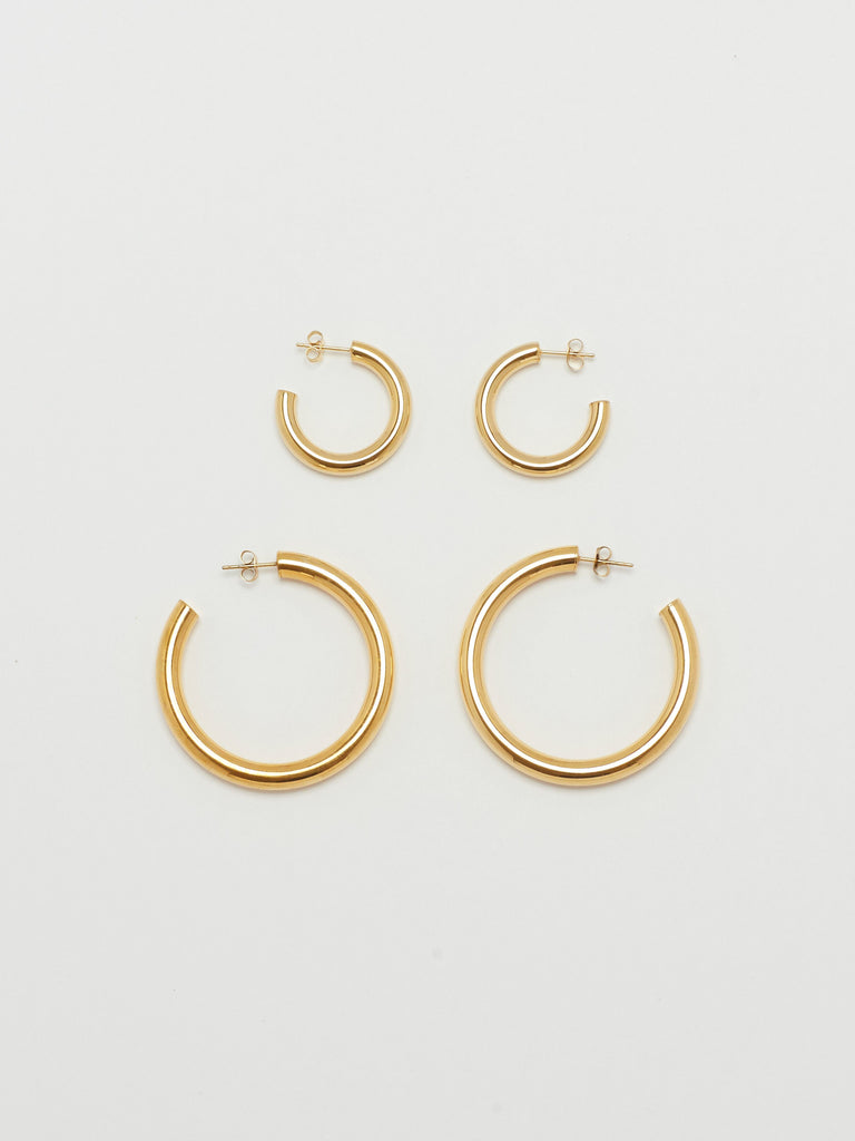 Full view flat lay of Gold Hollow Hoops & Mini Gold Hollow Hoops Earrings Bagatiba