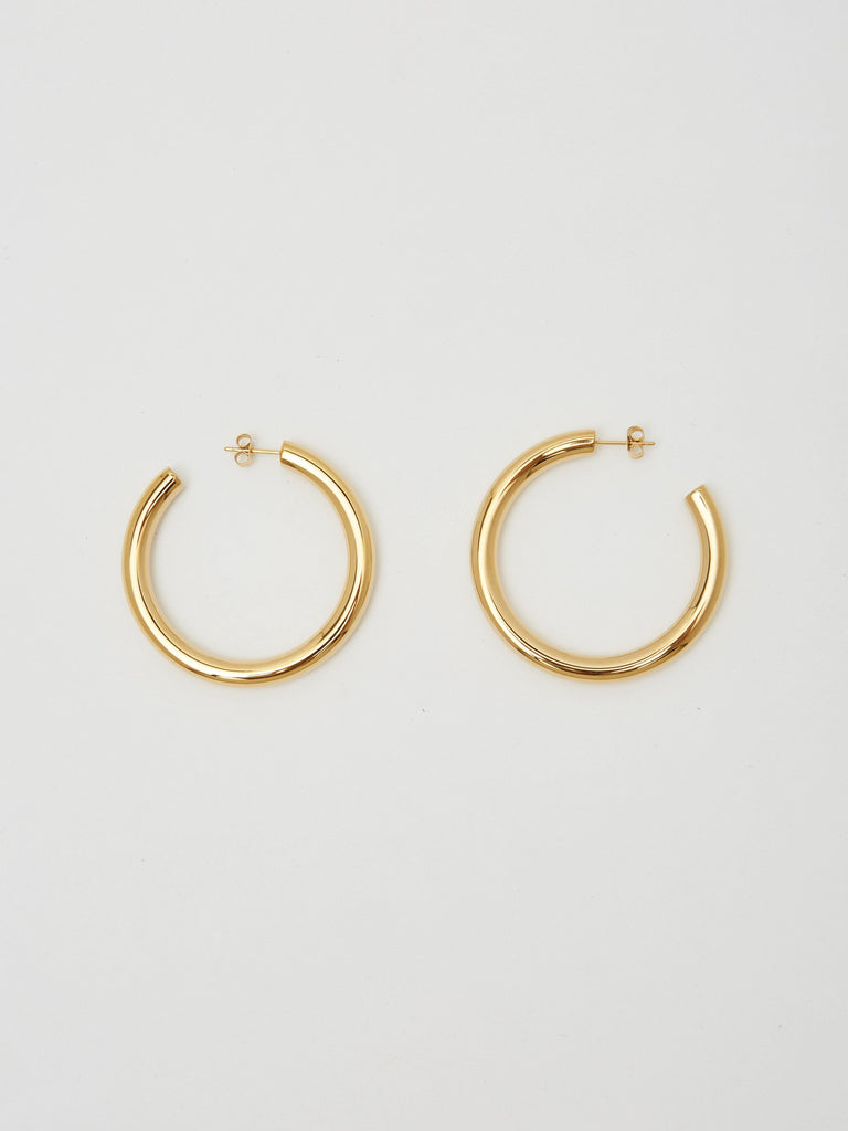 Full view flat lay of Gold Hollow Hoops Earrings Bagatiba