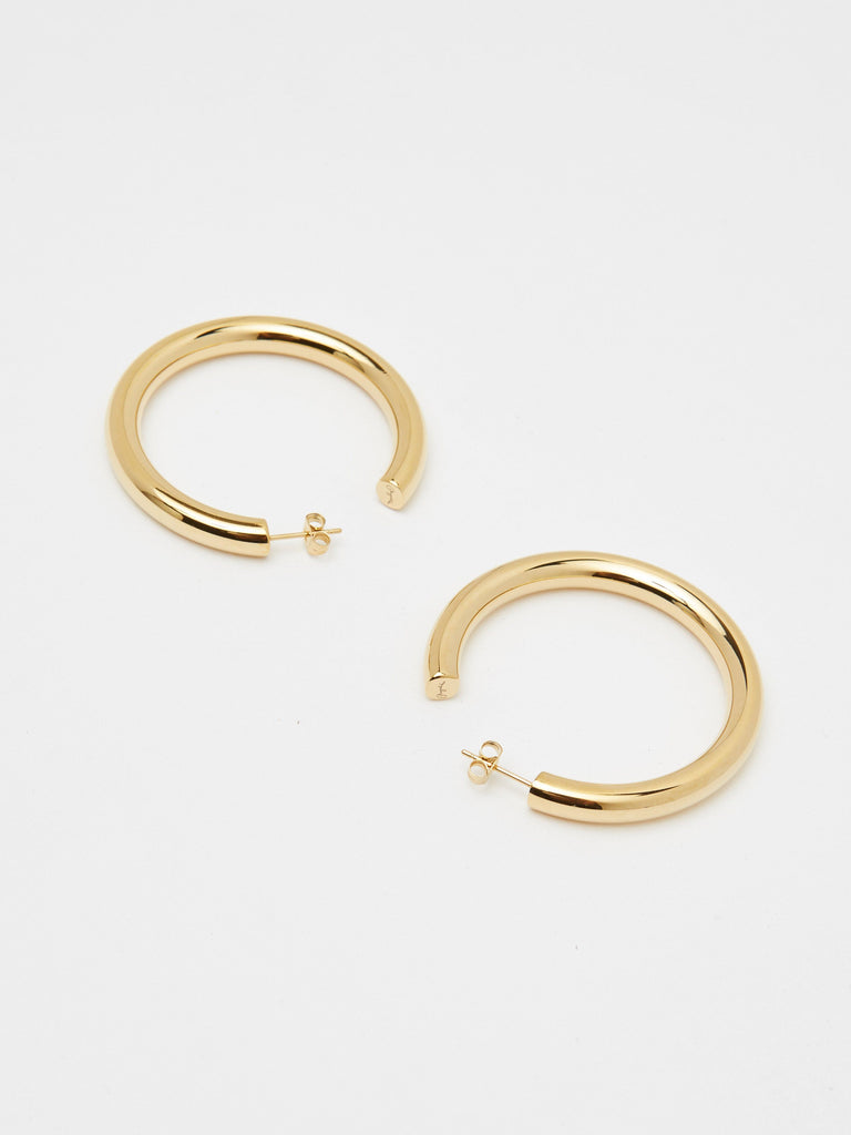 Flat lay view of Gold Hollow Hoops Earrings Bagatiba