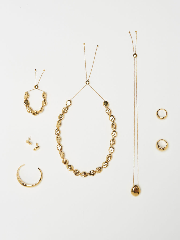 Full view flat lay of Orb Collection including the Gold Orb Cuff Bracelet bagatiba