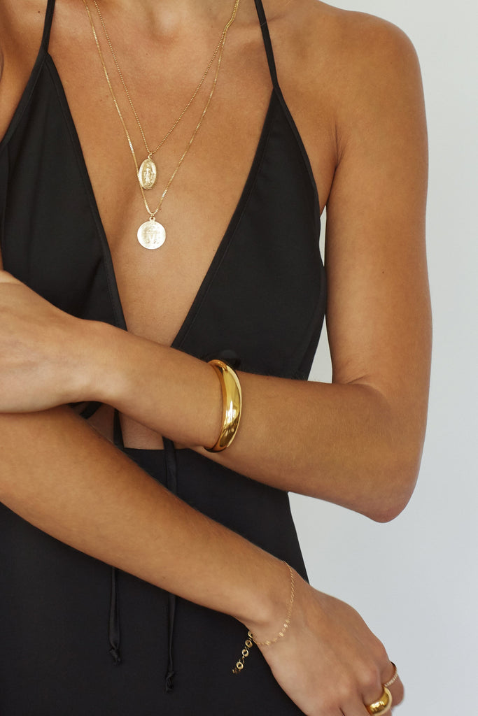 Cropped view on model of Gold Orb Cuff Bracelet bagatiba