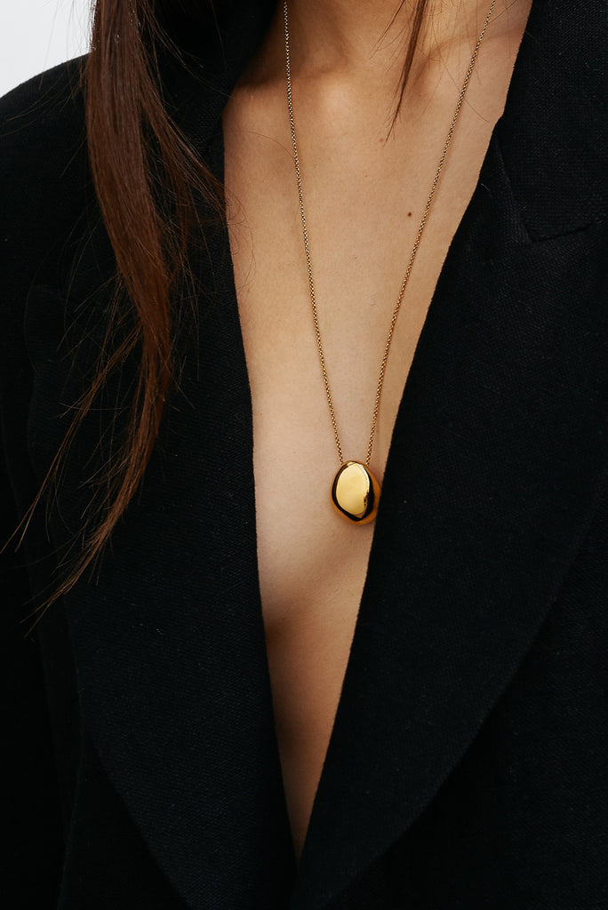 Cropped view on model of Gold Orb Necklace Necklace bagatiba