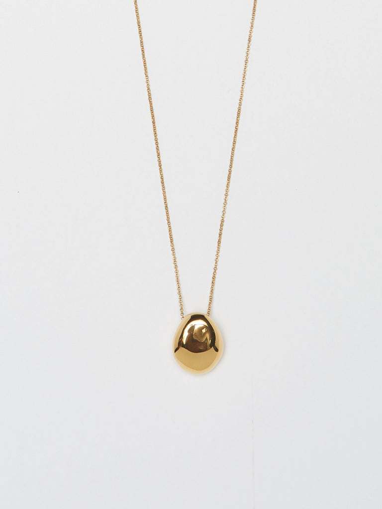 Cropped flat lay view of Gold Orb Necklace Necklace bagatiba