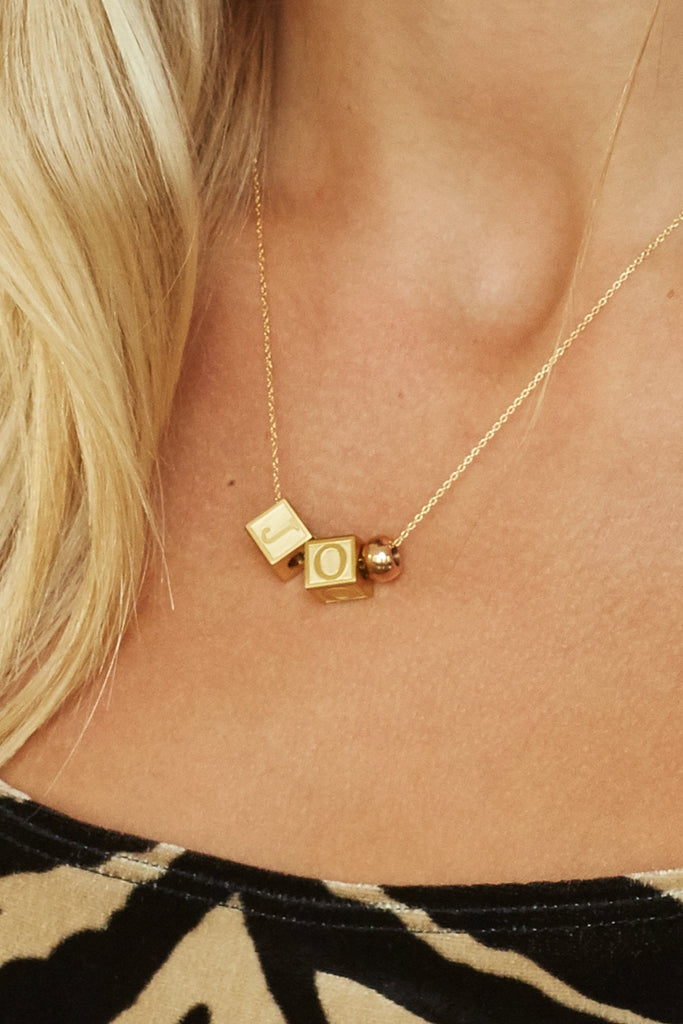 "Close up of model wearing ""J"" ""O"" Letter Block letters & 1 rose gold bead  Bagatiba"