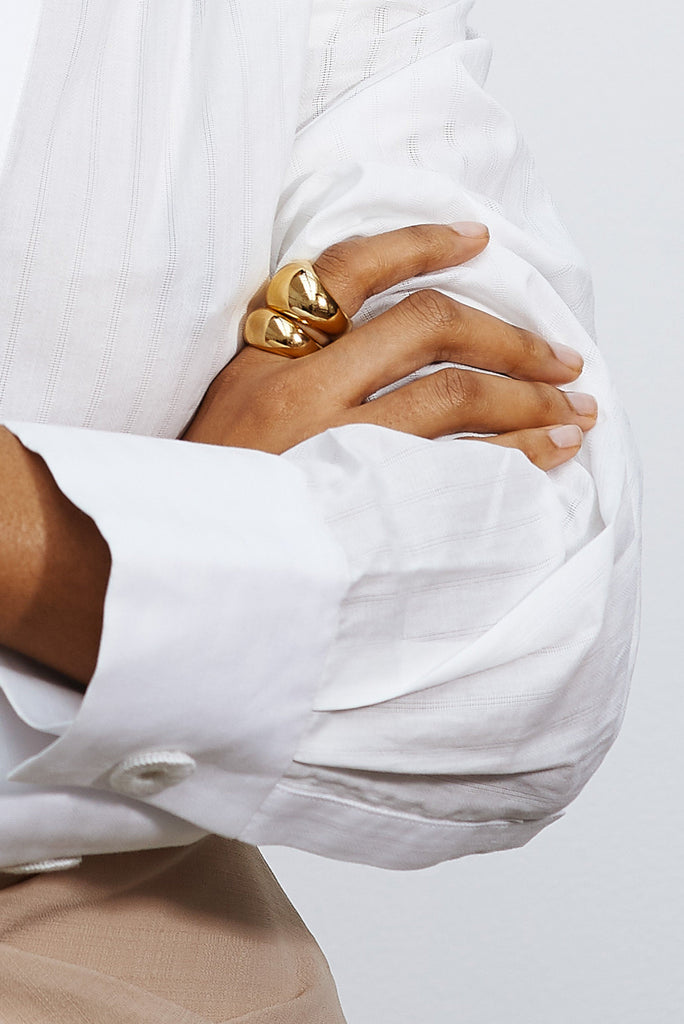 Detail view of hand with Large Gold Orb Ring Ring bagatiba