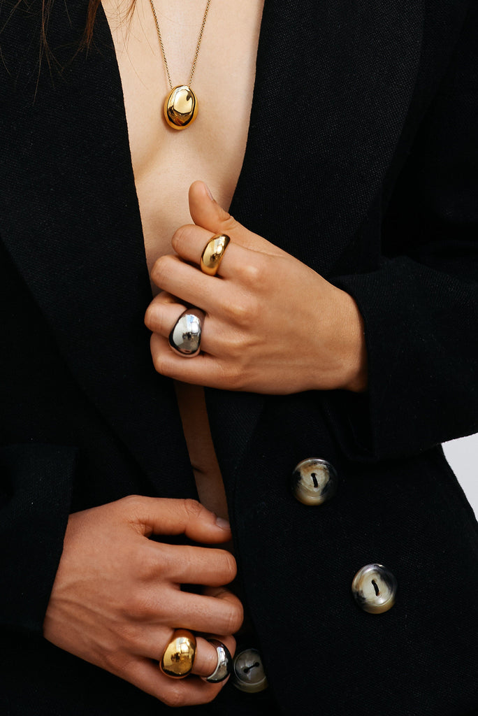 Cropped view of model wearing Large Gold Orb Ring Ring bagatiba