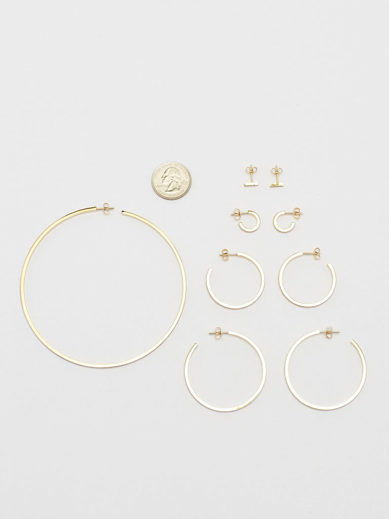 Full collection flat lay including the Medium Diamond Hoops Earrings Bagatiba