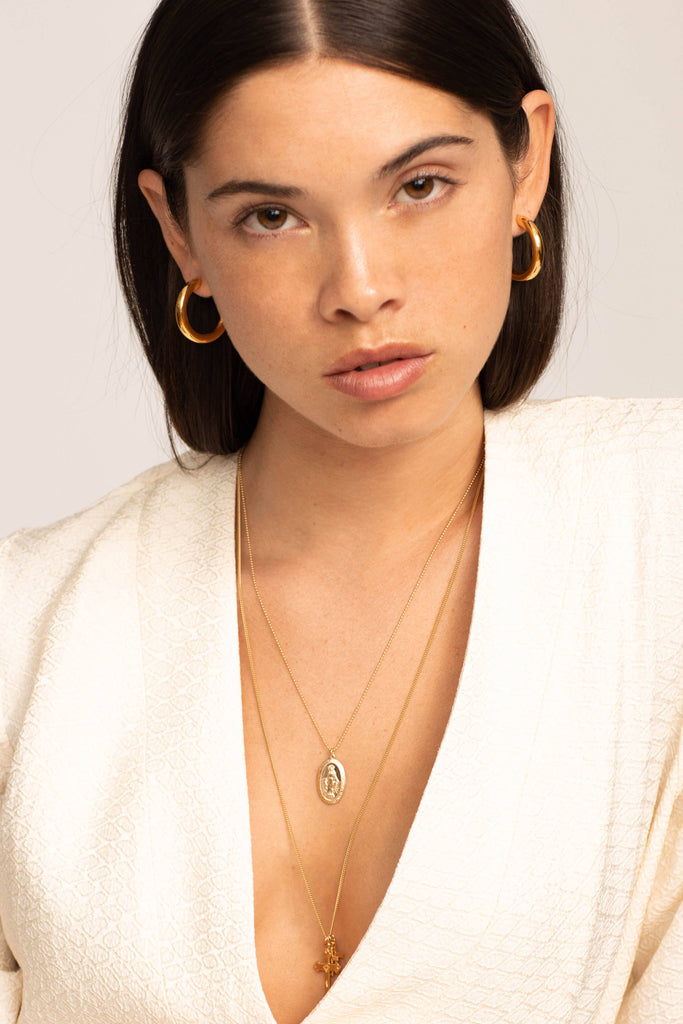 Model profile view wearing the Mini Gold Hollow Hoops Earrings Bagatiba