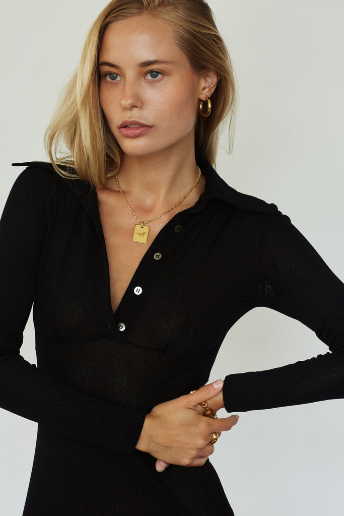 Model wearing the Mini Gold Hollow Hoops Earrings Bagatiba