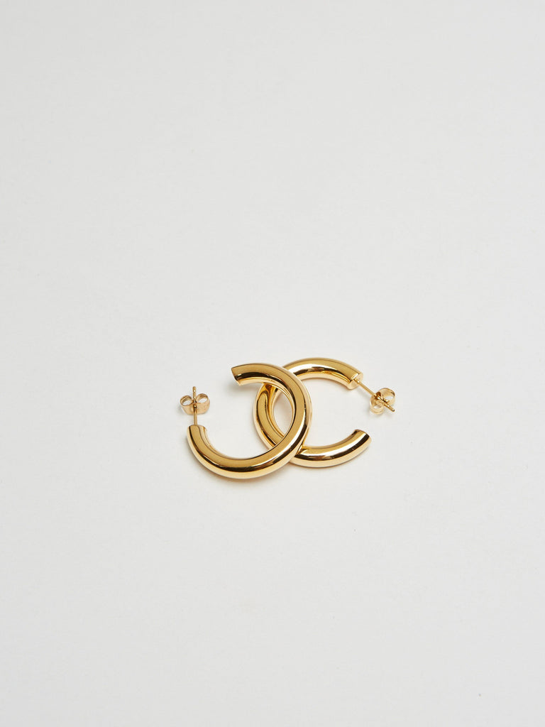 Detail flat lay of Mini Gold Hollow Hoops Earrings Bagatiba