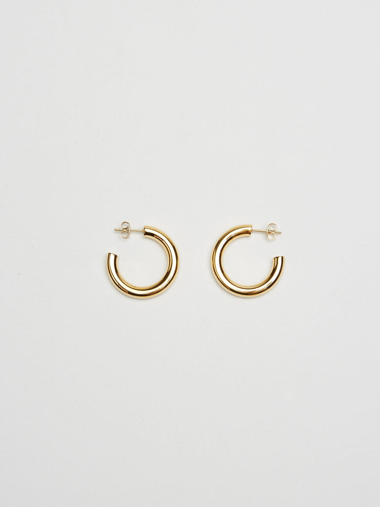Full view flat lay of Mini Gold Hollow Hoops Earrings Bagatiba