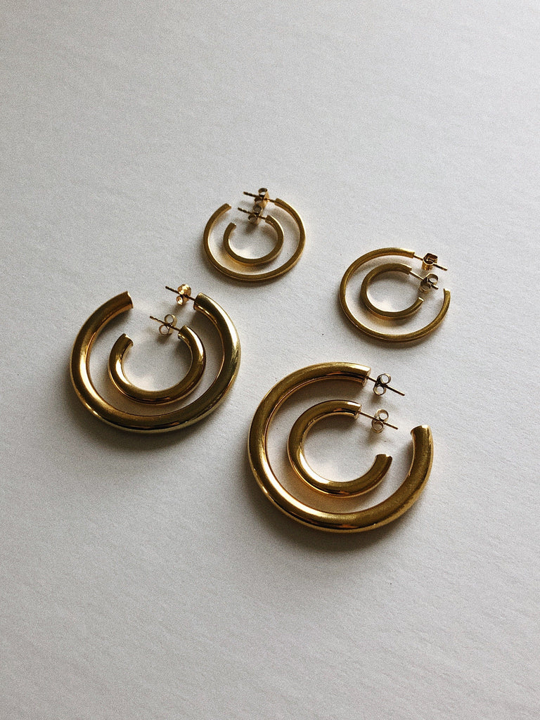 Full collection flat lay with Mini Gold Hollow Hoops Earrings Bagatiba