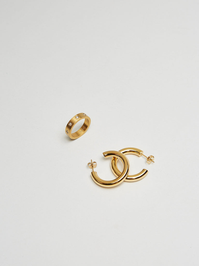 Detail flat lay of Gemma Ring & Mini Gold Hollow Hoops Earrings Bagatiba