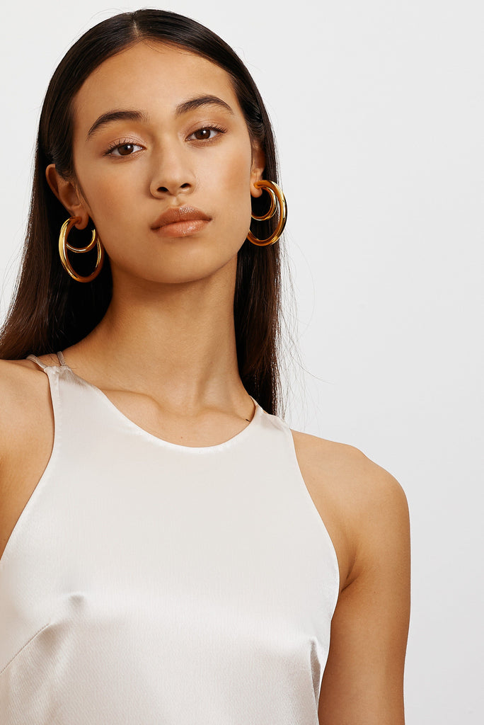 Model wearing Mini Gold Hollow Hoops & Gold Hollow Hoops  Earrings Bagatiba